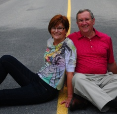 Betty and Jim Healey posing on a road